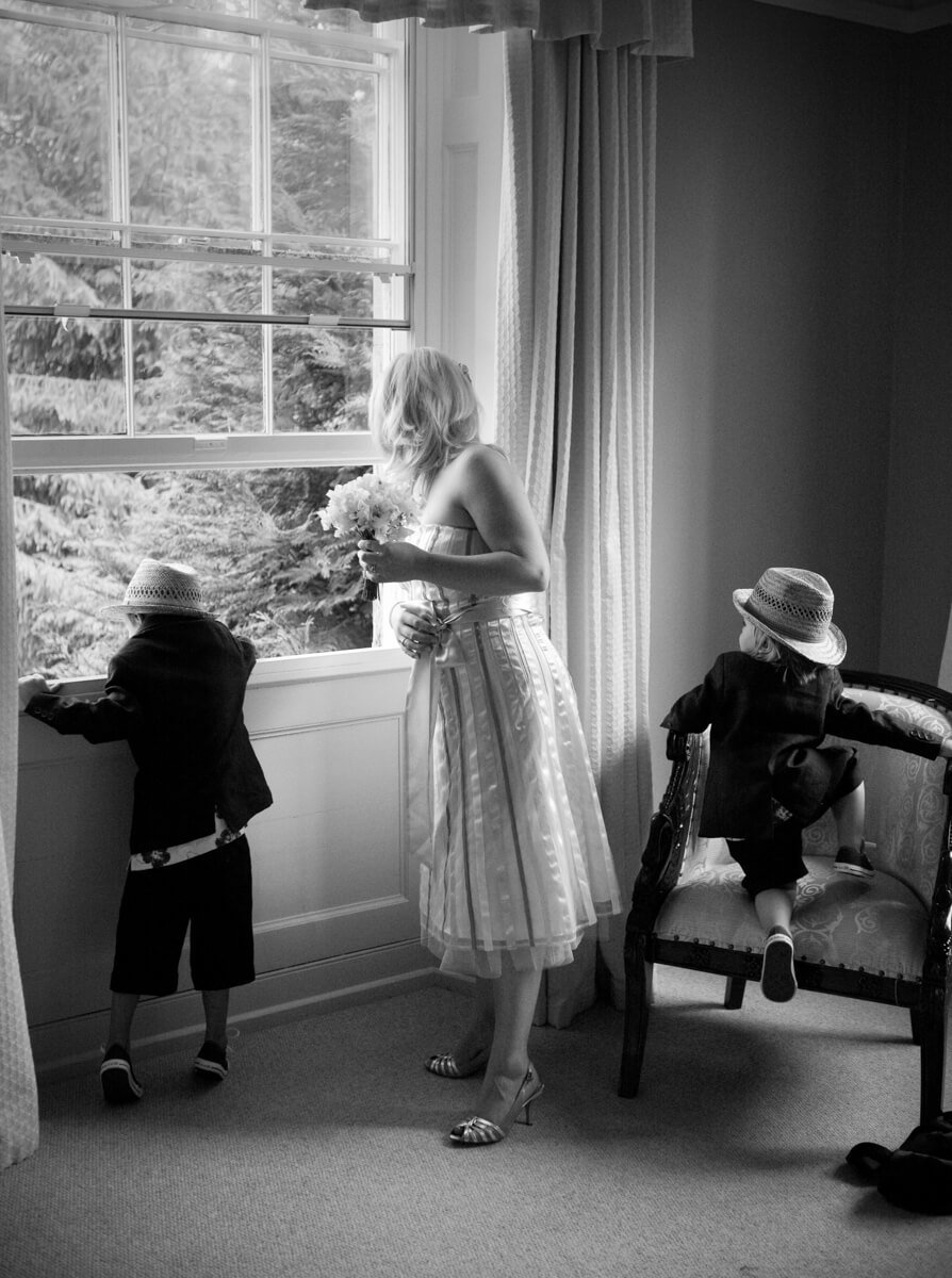 Bridesmaid and pageboys looking out of window at Lemore Manor weddings