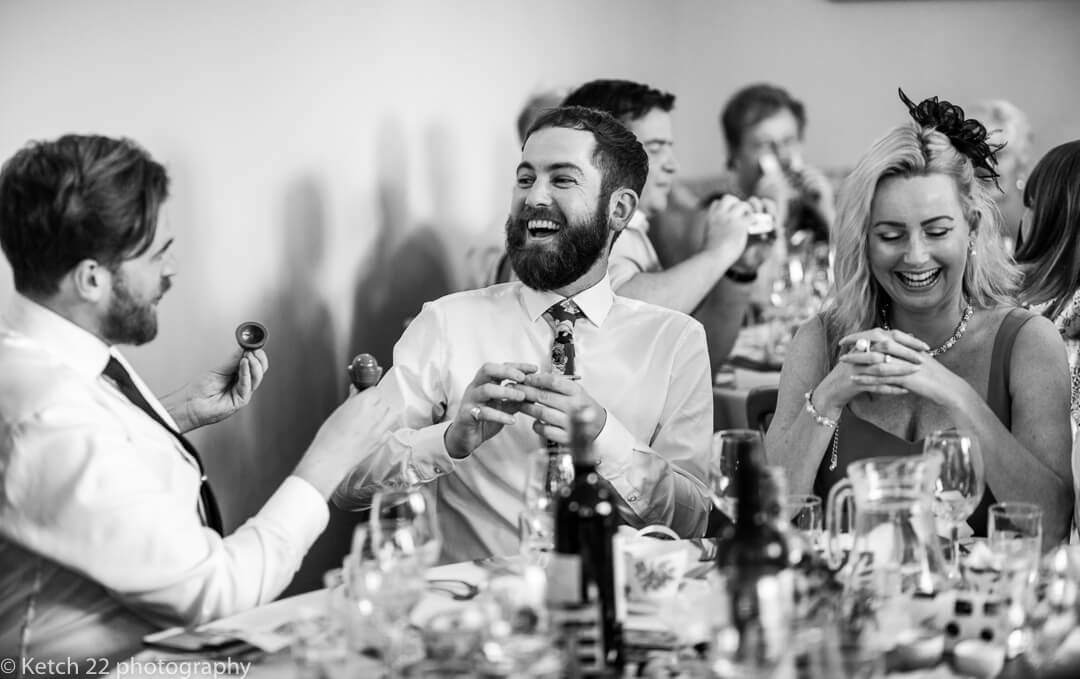 Wedding guest laughing at speeches at Whitney Court