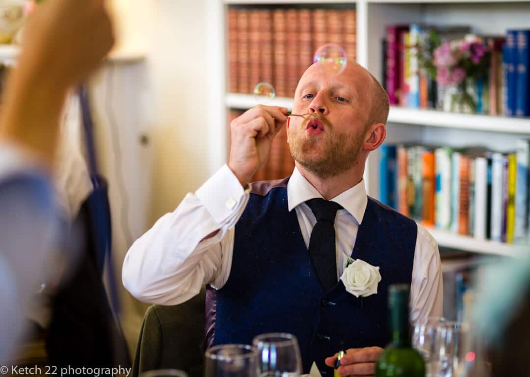 Wedding guest blowing bubbles at Country House