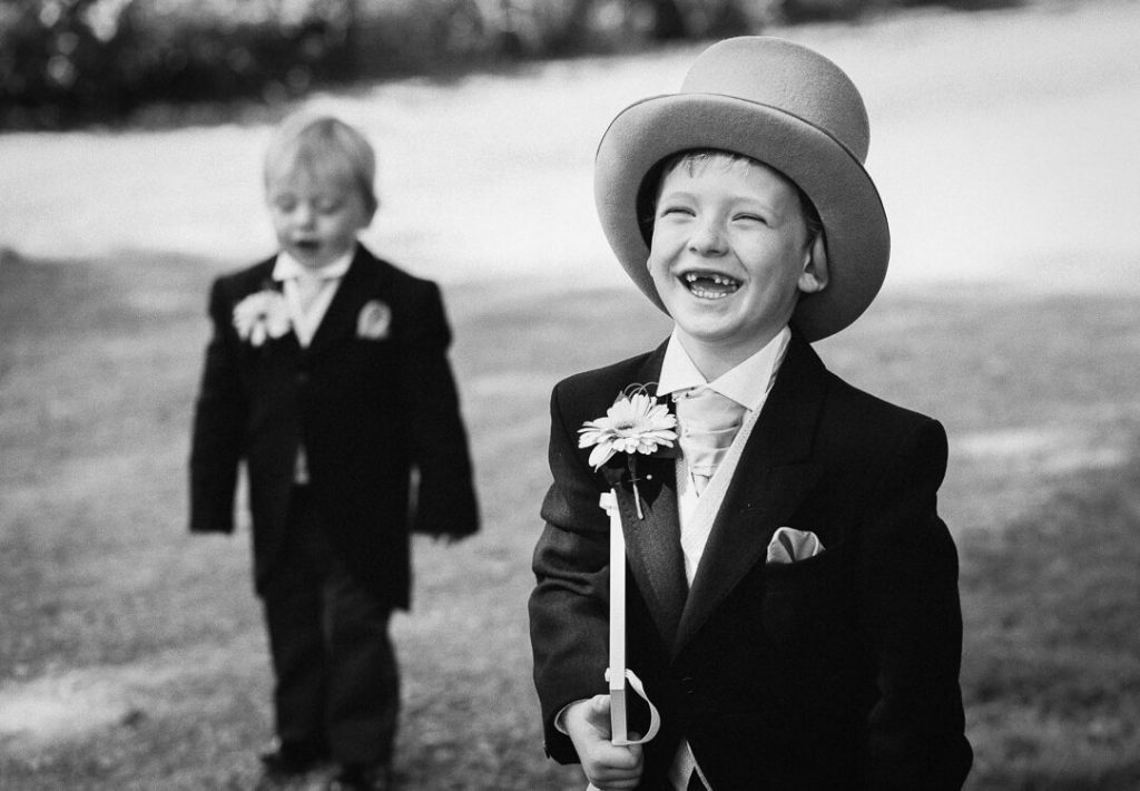 Page boy wearing top hat and tails at Cheltenham wedding