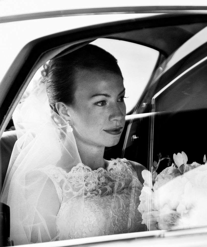 Portrait of Bride in car at wedding
