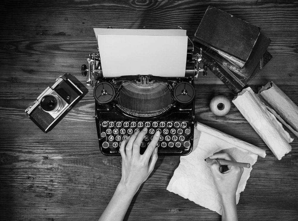 type writer and camera for Ketch 22 photography contact page