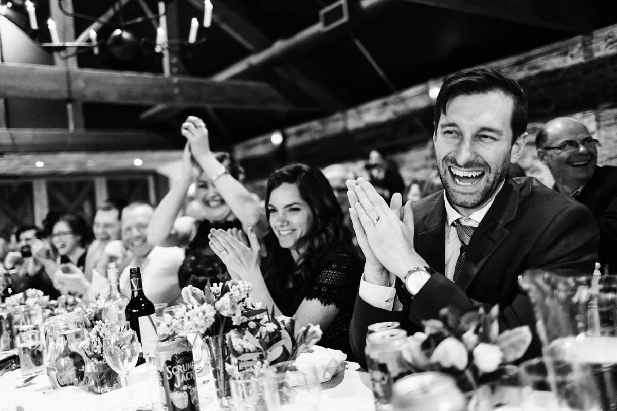 wedding guests cheering during speeches in Gloucestershire