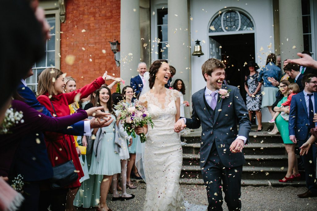 Wedding confetti with bride and groom at wedding in Cheltenham