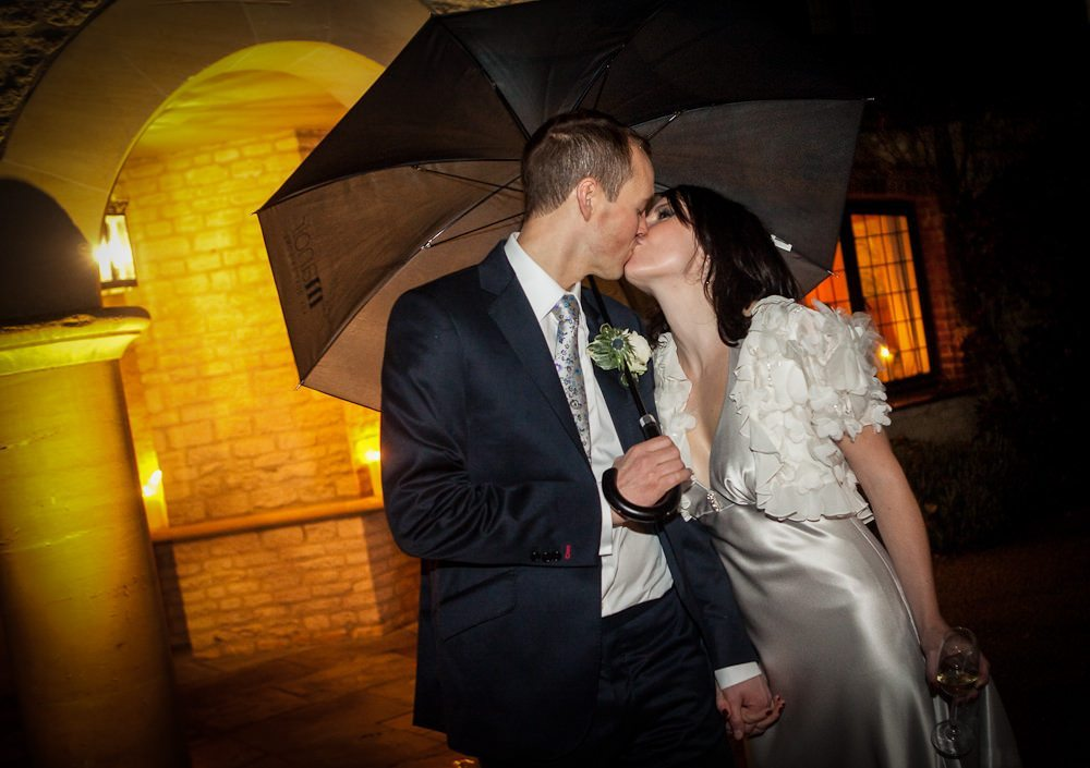Bride and groom kissing at winter wedding Gloucestershire