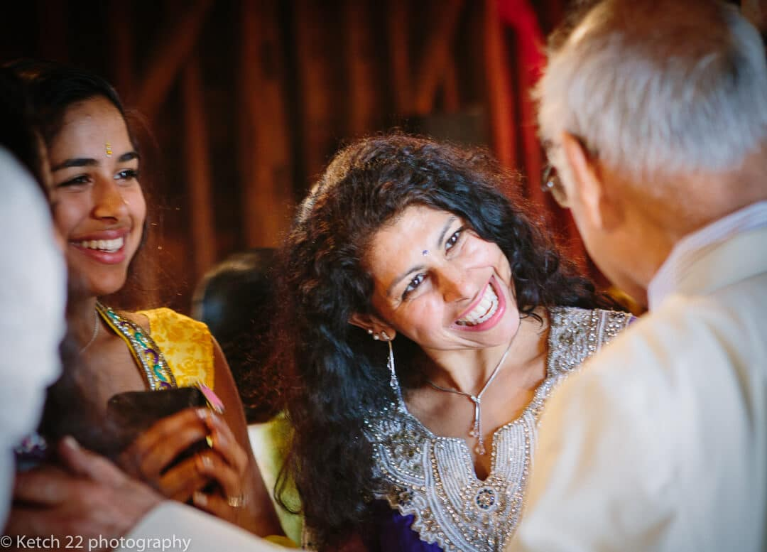 Wedding guests greet each other at Indian Henna night
