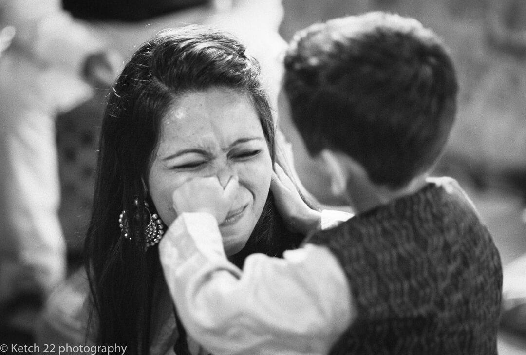 Kid pinching mums nose at Indian Henna night