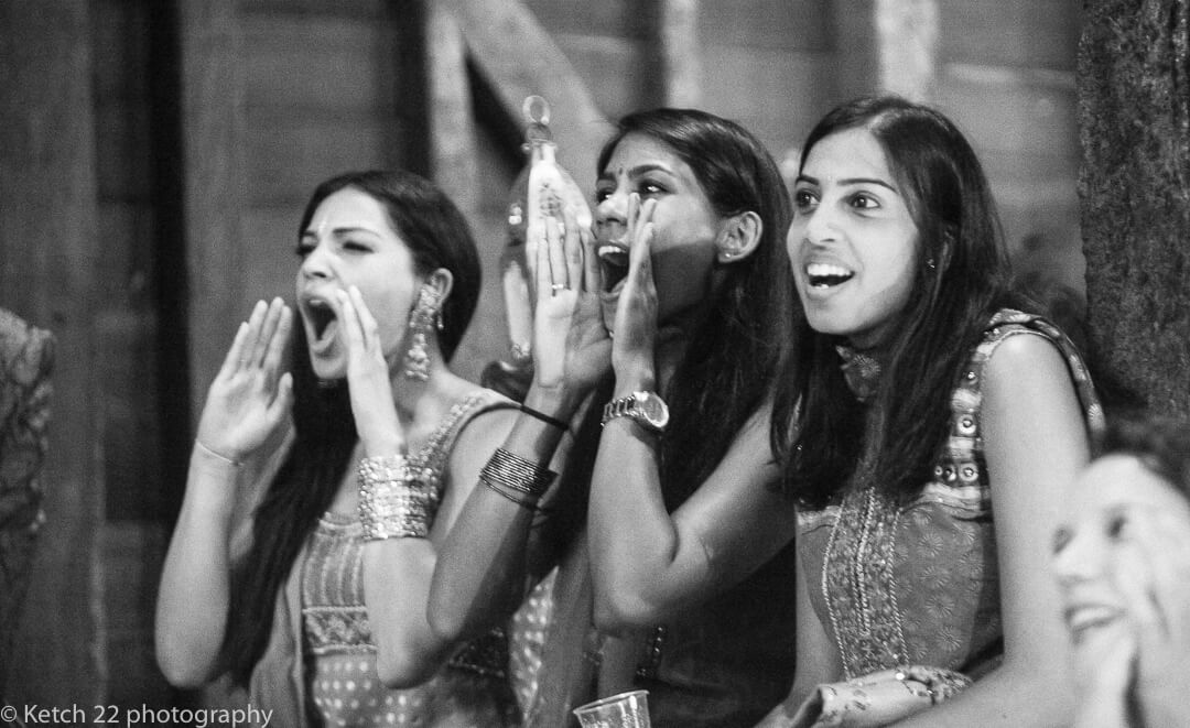 Indian wedding guests cheering and shouting