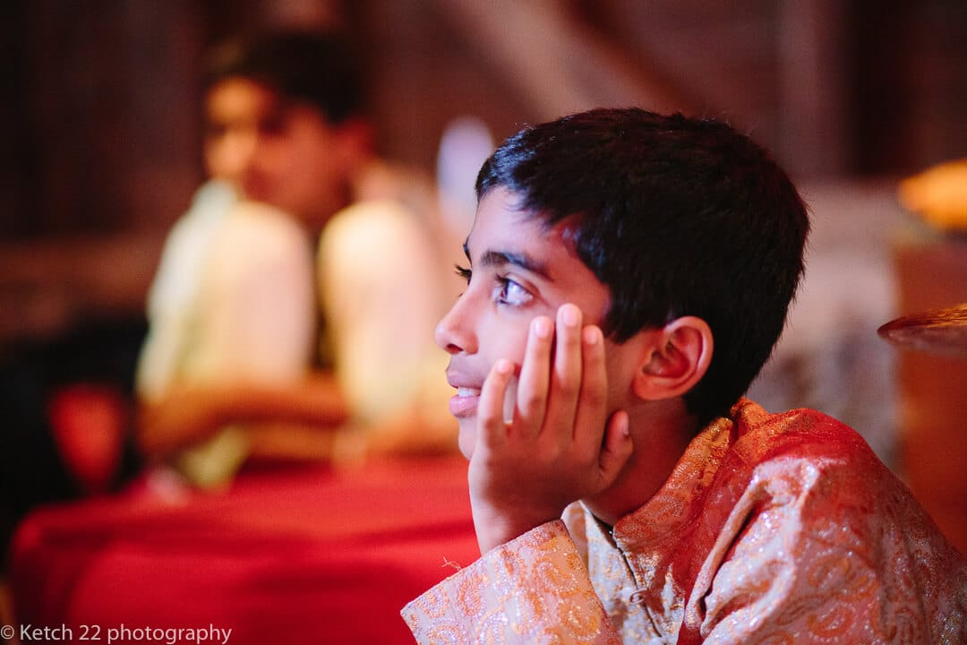 Young boy in Indian costume at Hindu henna night