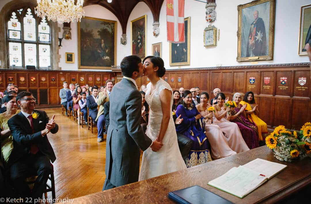 Indian bride and groom kissing at civil ceremony