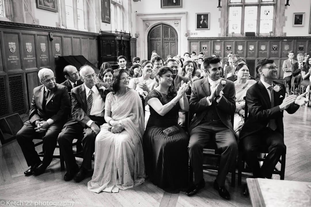 Wedding guests cheering at wedding ceremony