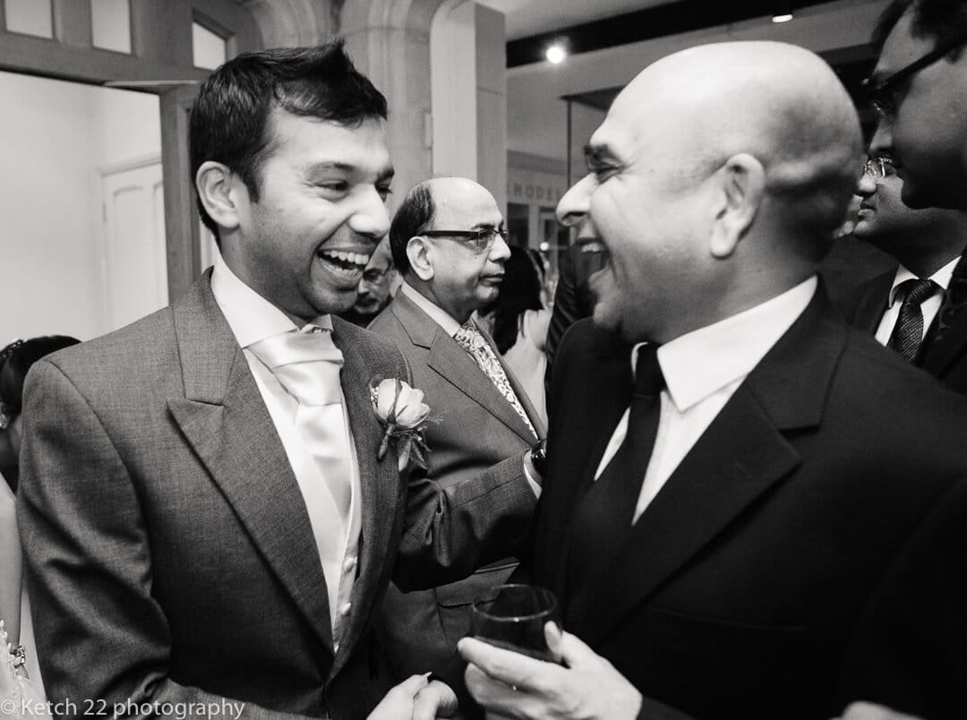 Groom greeting wedding guest after wedding ceremony