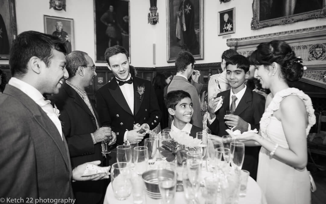 Wedding guests chatting at civil wedding ceremony in London