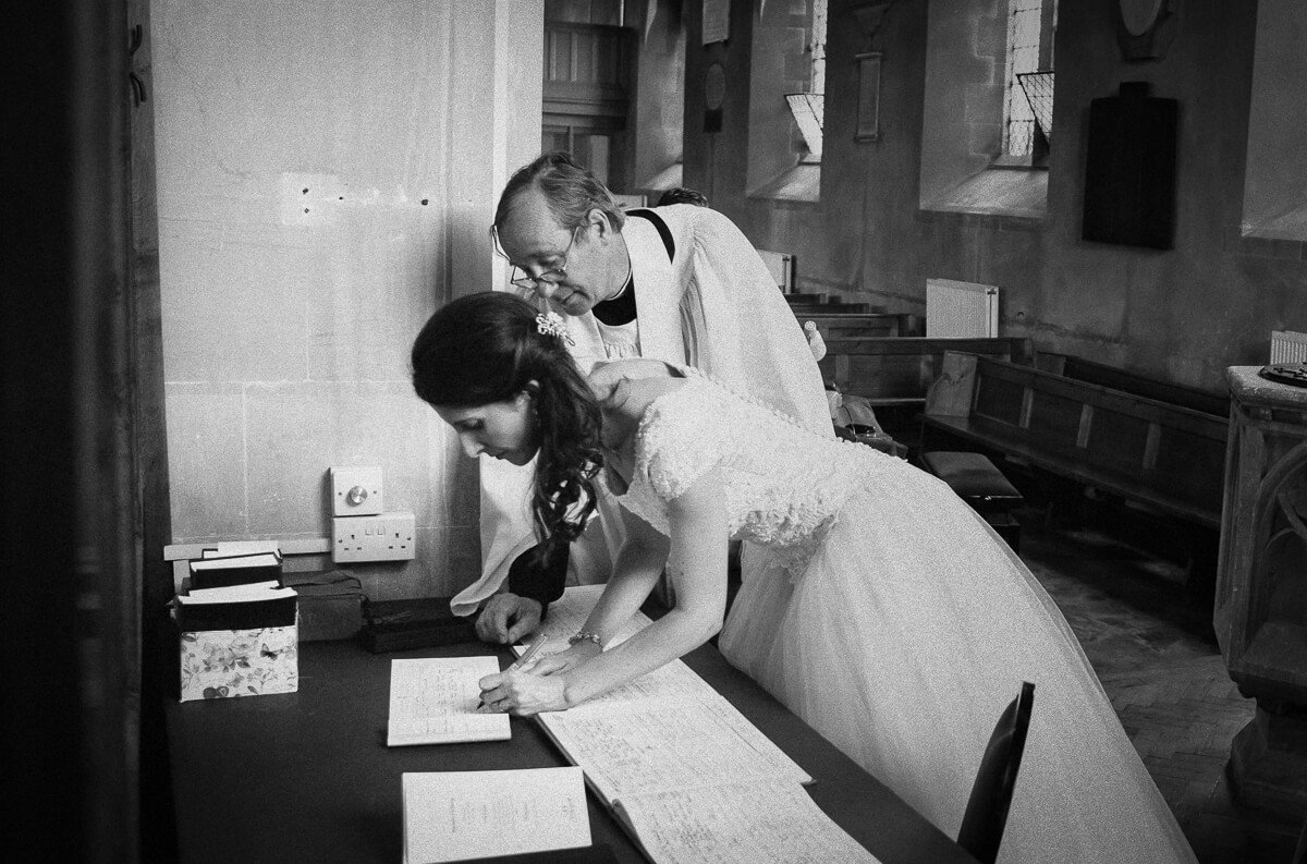Bride signing the book