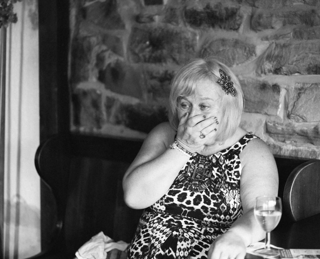 Grandma holds hand to her face at wedding in Shropshire