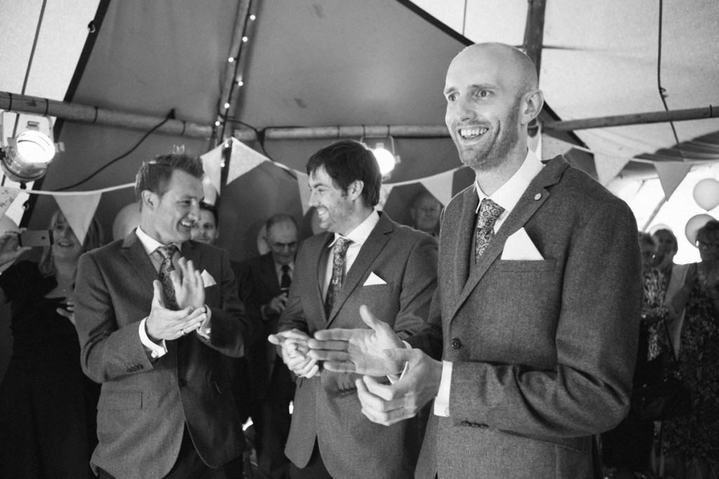 Groom clapping at bestman speechs at wedding in Shropshire