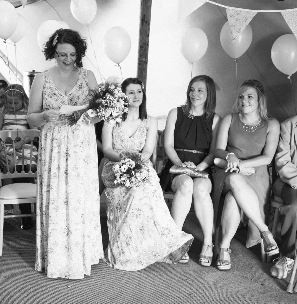 Bridesmaid giving a reading at wedding ceremony in Shropshire