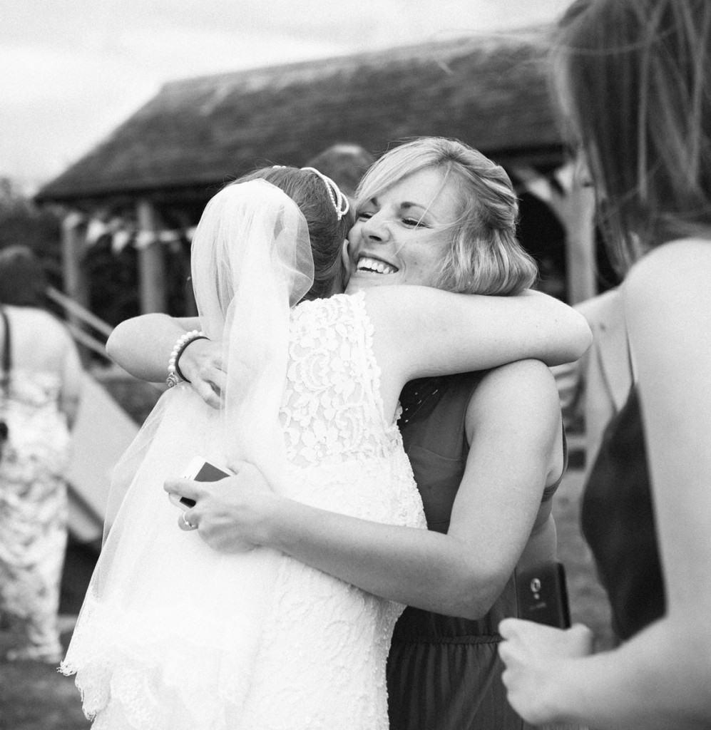 Bride hugging guest at wedding in Shropshire