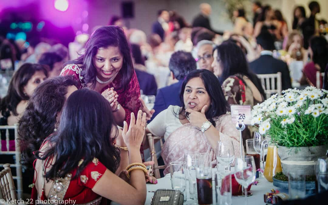 Wedding guests chatting during wedding breakfast