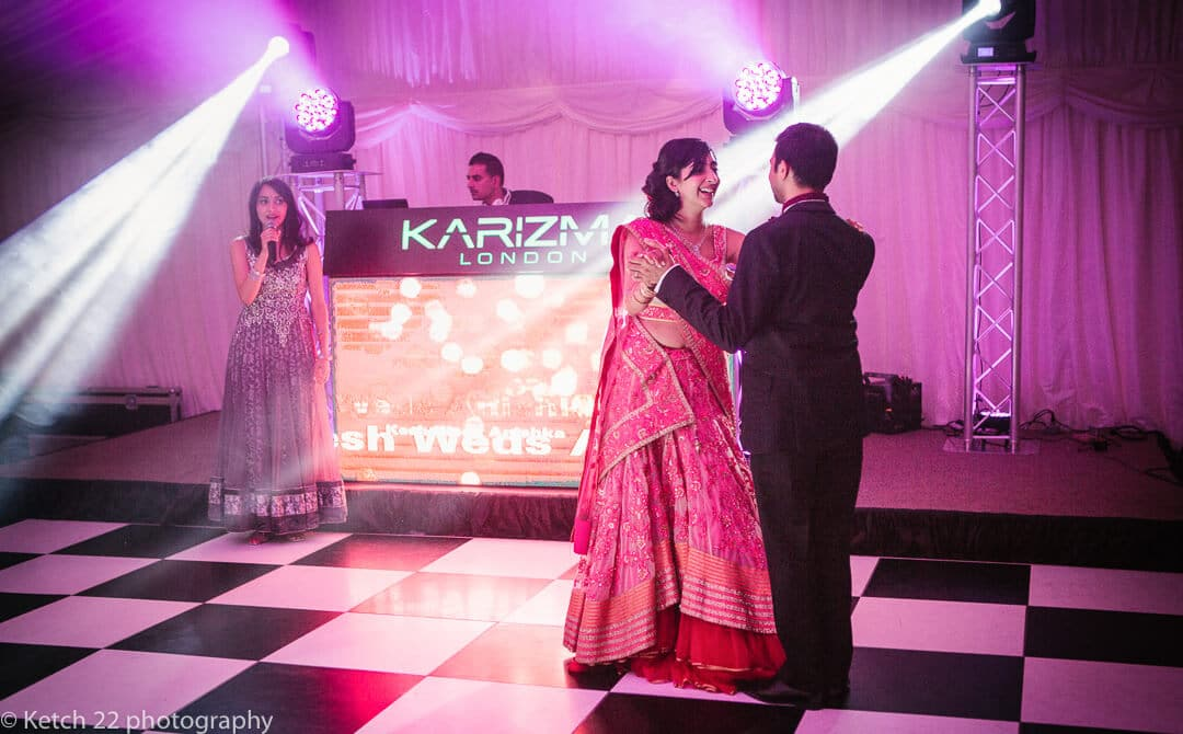 Bride and groom at first dance at Indian wedding in London