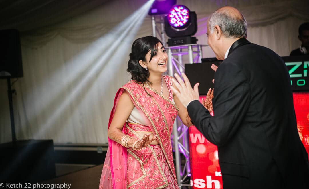 Bride dancing with her father at Indian wedding at Micklefield Hall