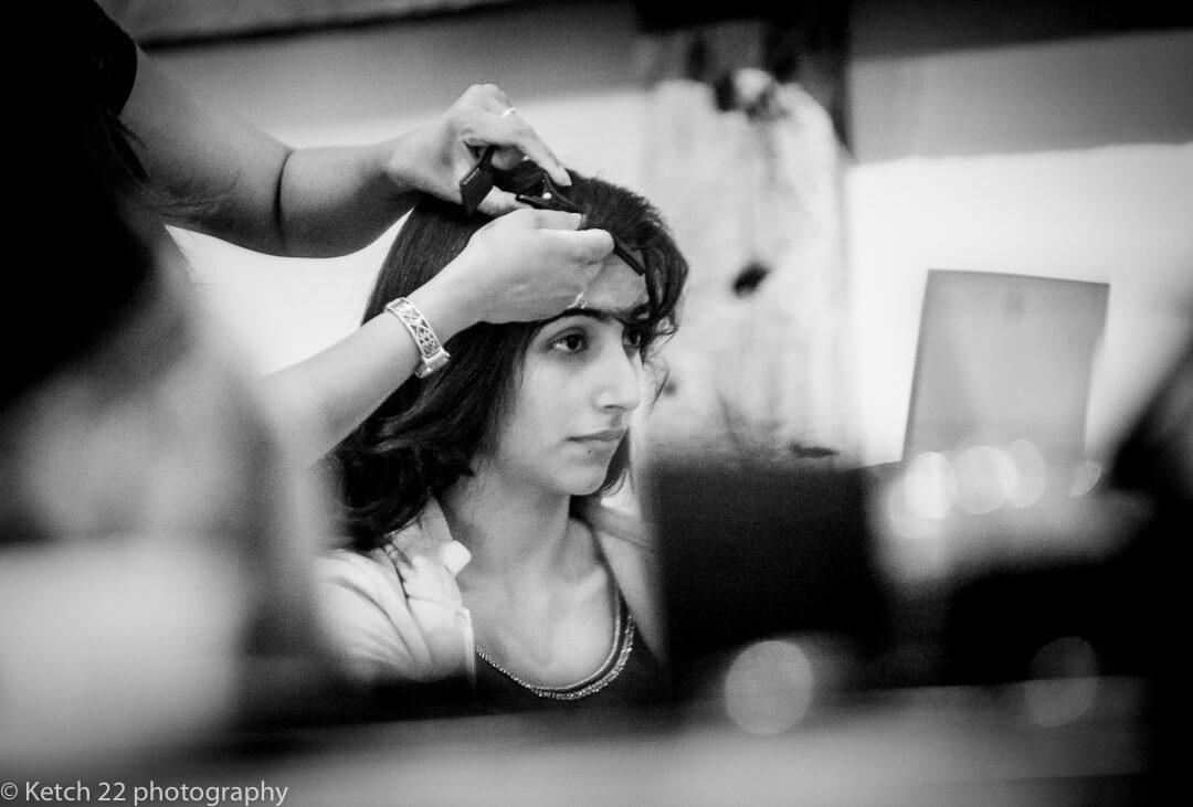 Bridesmaid getting ready at Hindu wedding