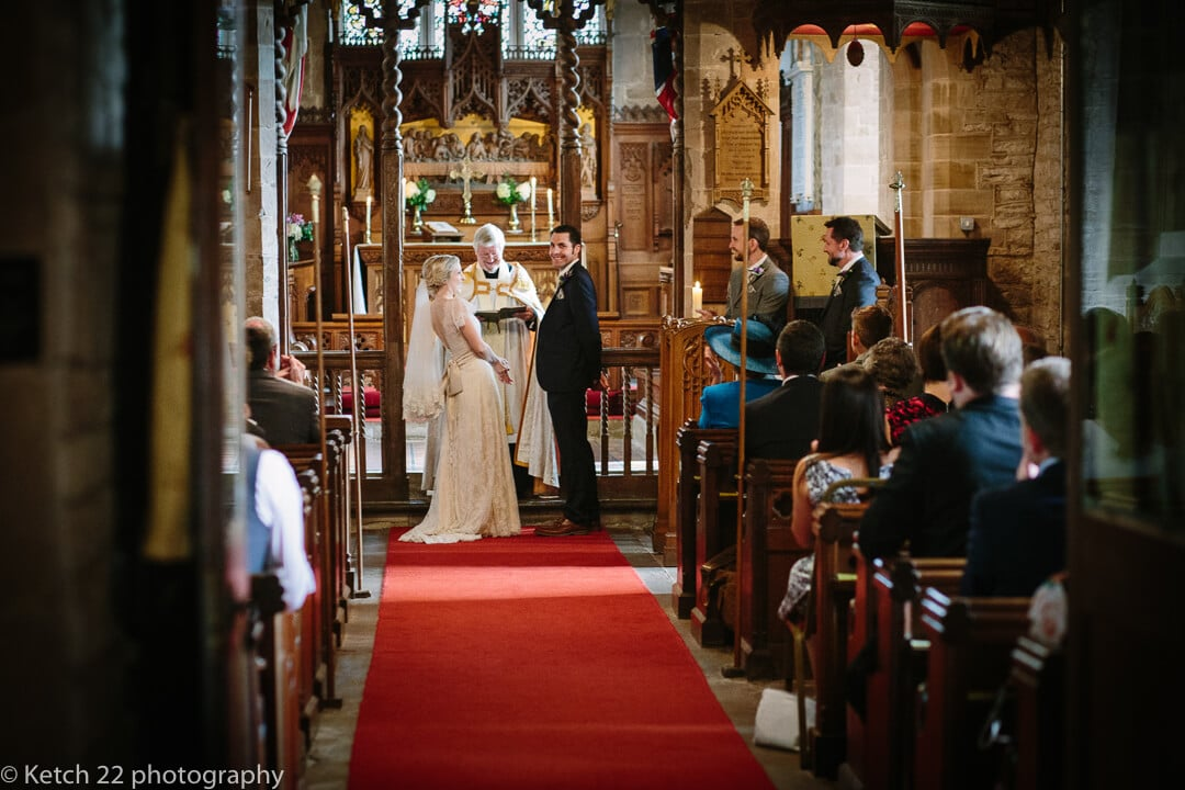 Bride and groom exchanging vows at Herefordshire wedding