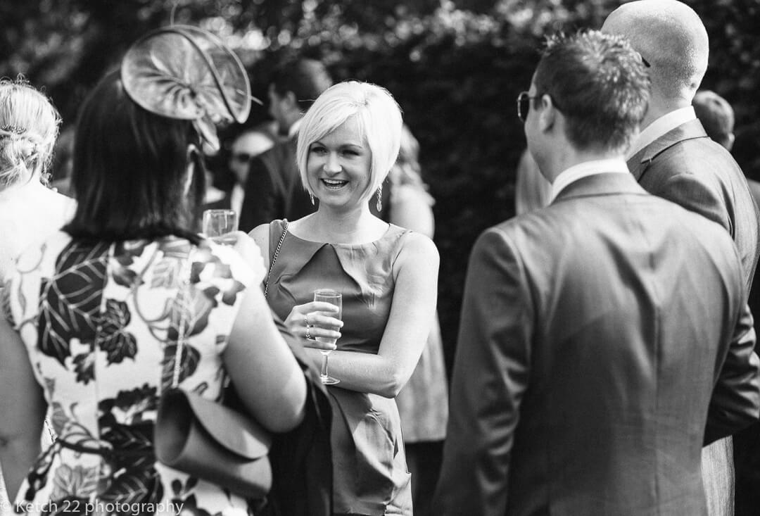 Candid photo of wedding guests chatting