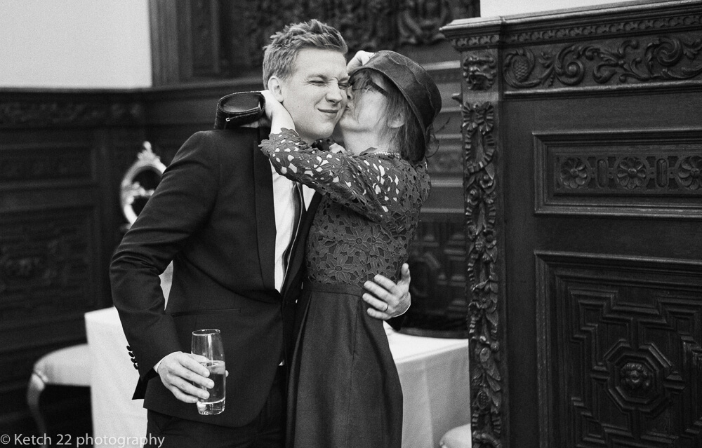 Big kiss from Mum at Manor by the lake wedding Gloucestershire