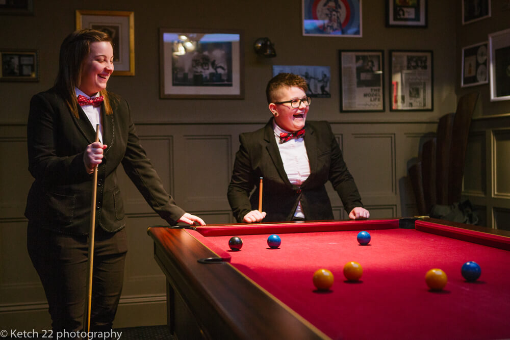 Playing pool at manor by the lake wedding Gloucestershire