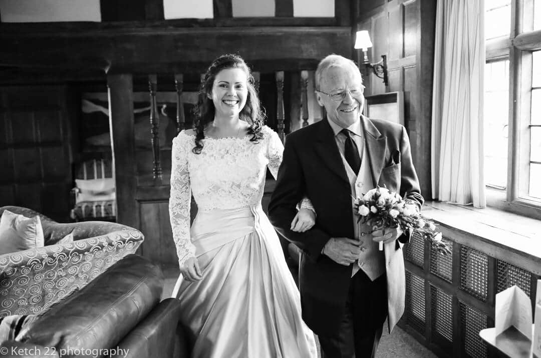 Father and bride walking to wedding ceremony room in Herefordshire