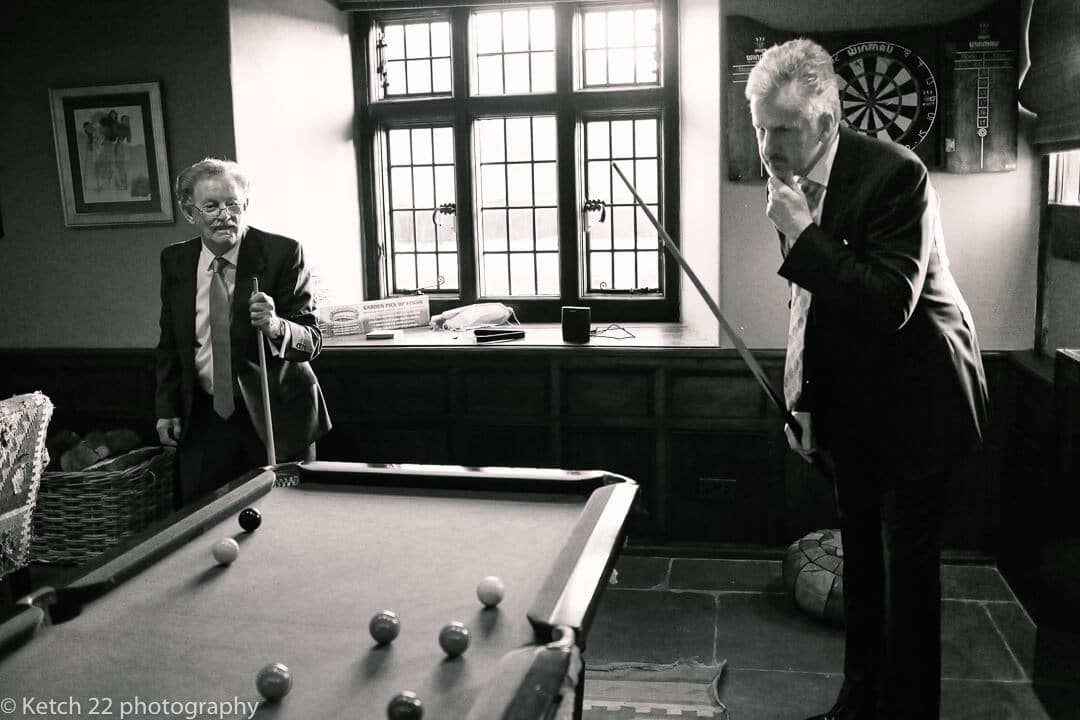 Wedding guests playing pool at Brinsop Court