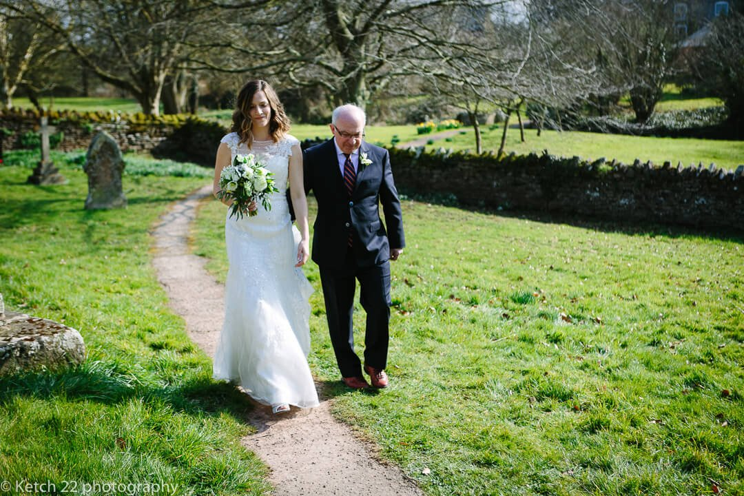 Father and bride arriving at church at spring wedding