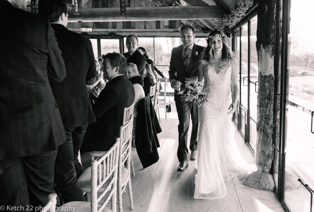 Bride and groom enter dinning room at wedding