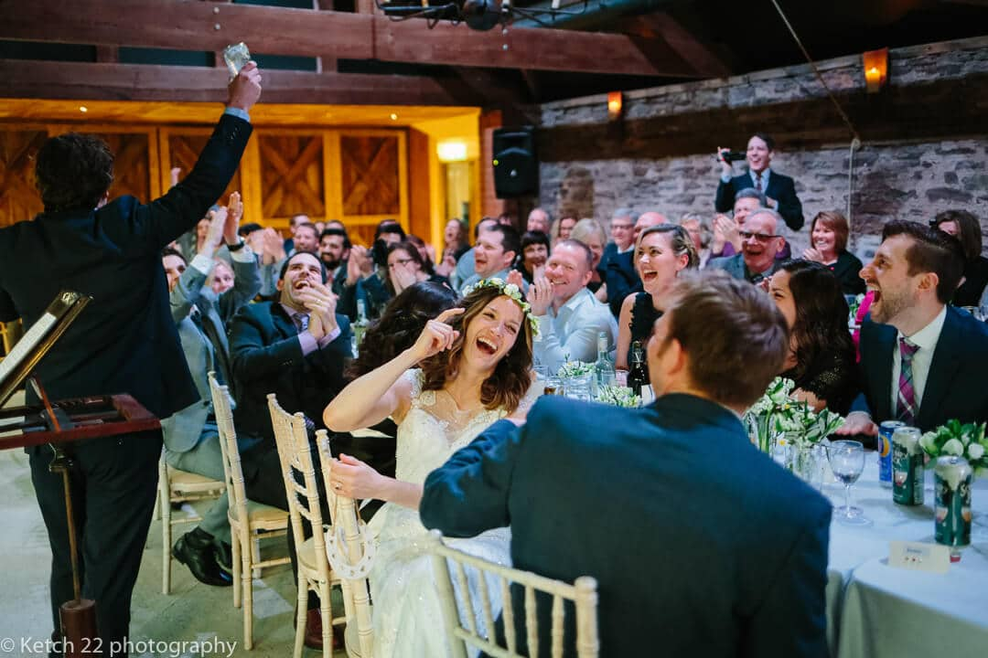 Bride and wedding guests reacting to speeches at Herefordshire wedding