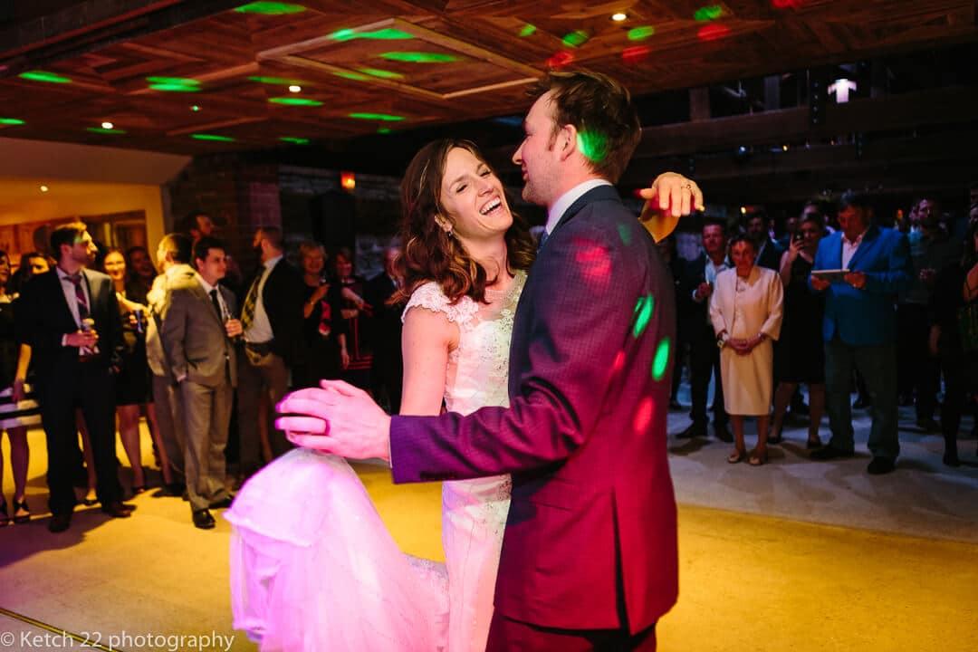 Bride and groom dancing at barn wedding reception