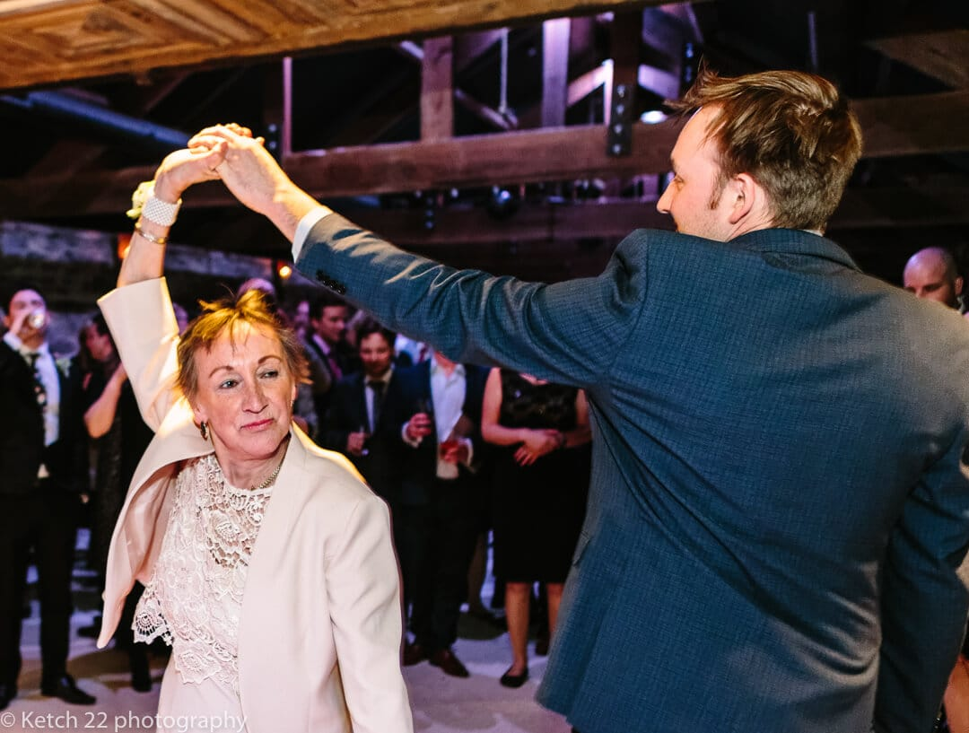 Groom dancing with grandma at wedding reception