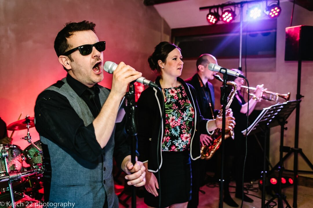 Wedding band performing at Dewsall Court