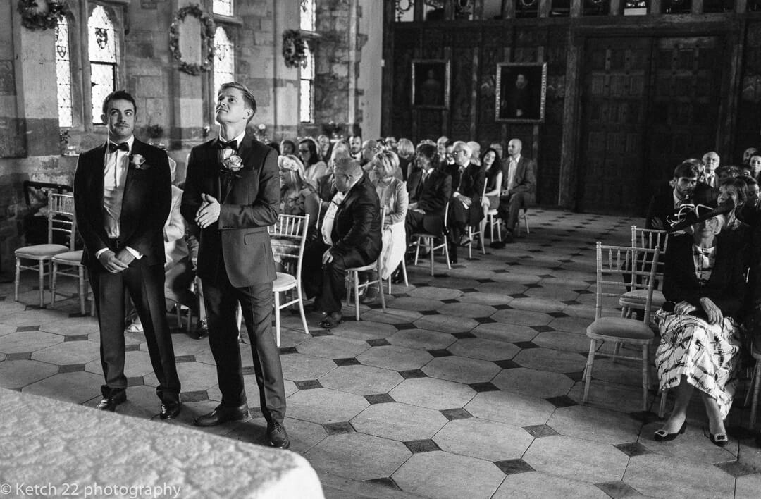 Groom looking anxious just before wedding ceremony
