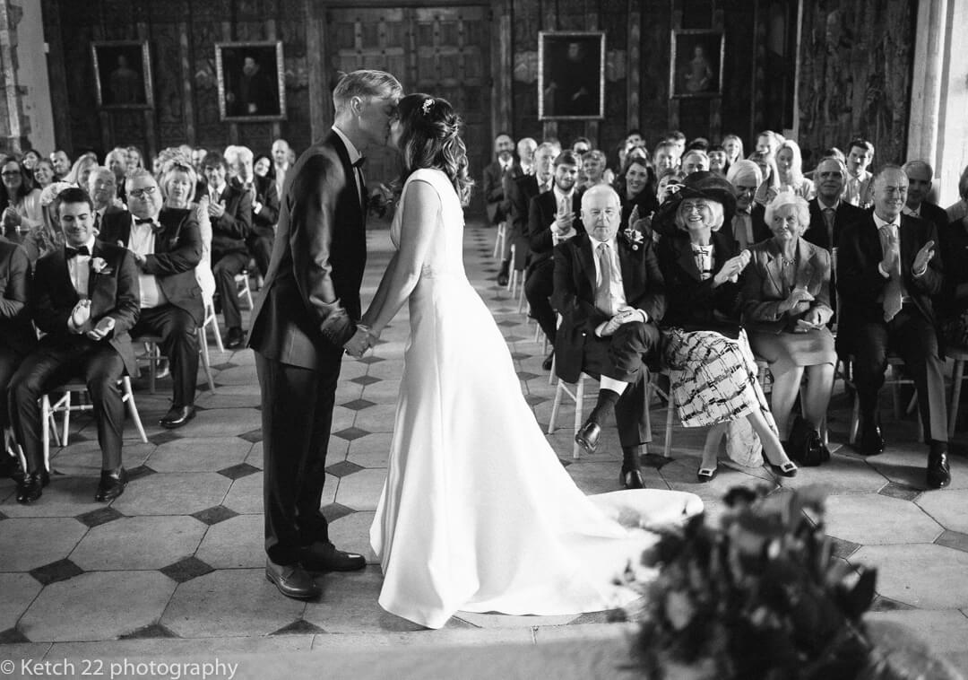 Bride and groom kissing at wedding ceremony at berkeley castle in Gloucestershire