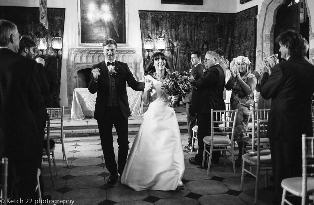 Groom punching the air after Gloucestershire wedding ceremony