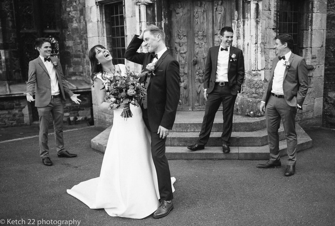Funny reportage photo of bride and groom at Castle wedding