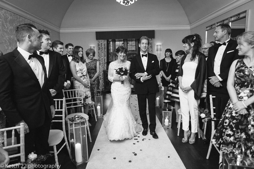 Bride and brother walking down aisle at Gloucestershire wedding