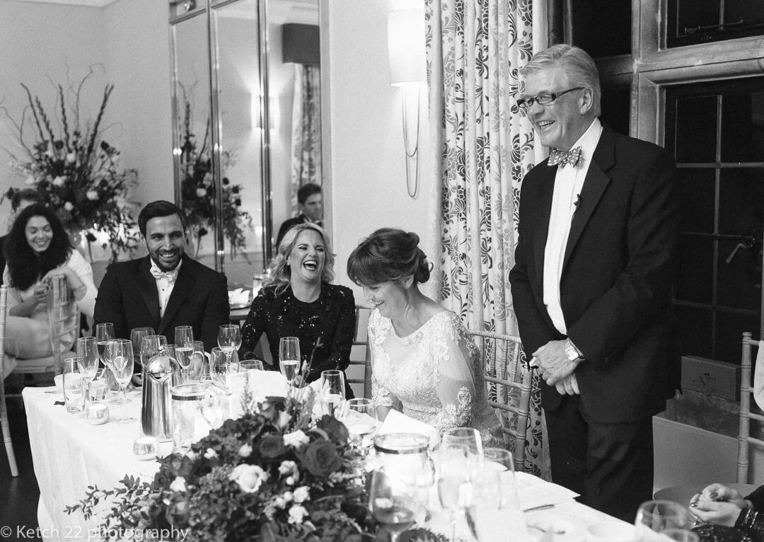 Elderly groom speaking at wedding speeches in Gloucestershire