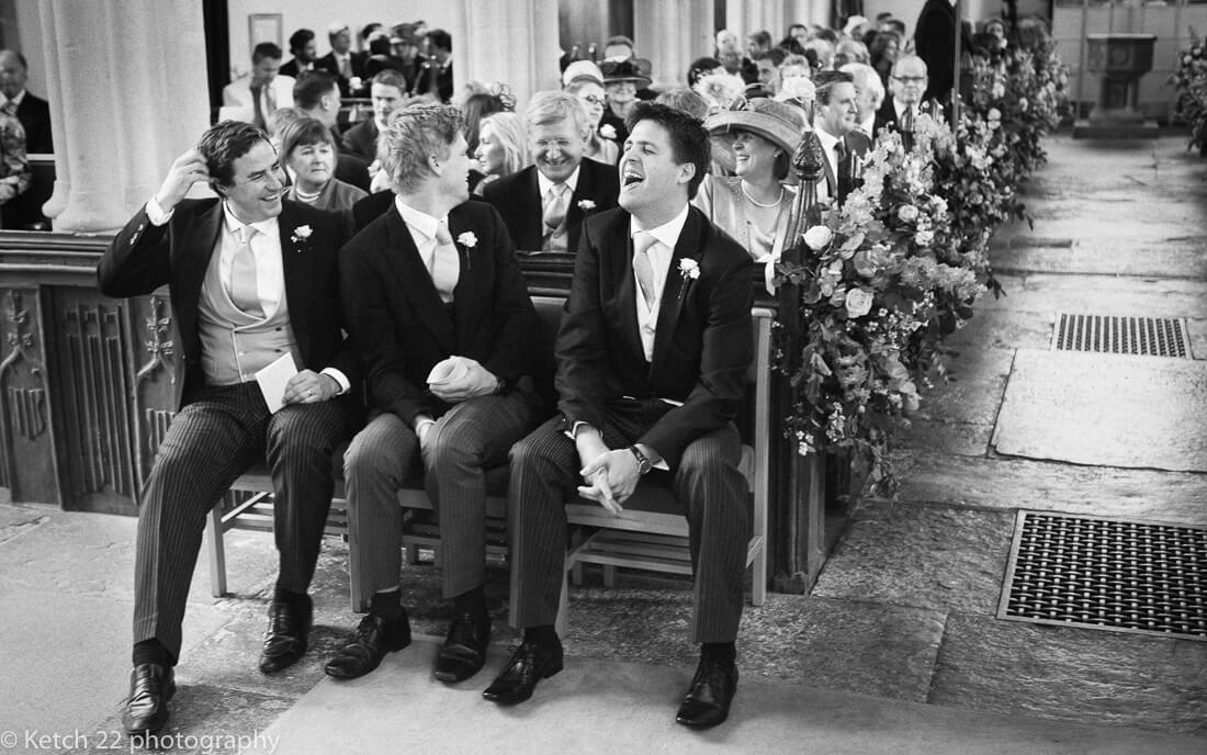Groom and ushers laughing prior to wedding ceremony