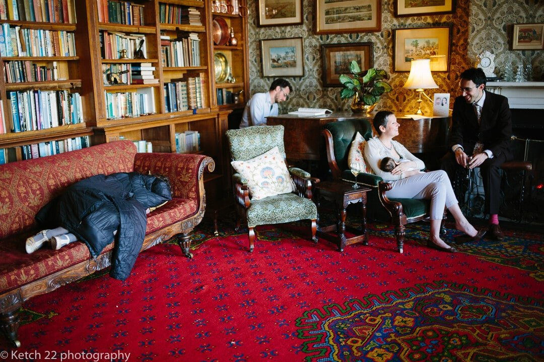 Story telling wedding photo of guests relaxing in lounge