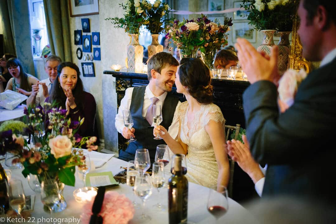 Bride and groom share an intimate moment at wedding speeches