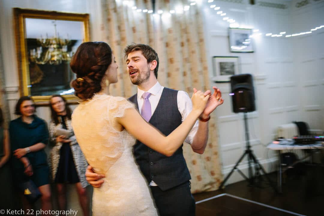 Candid wedding photo of bride and groom at first dance