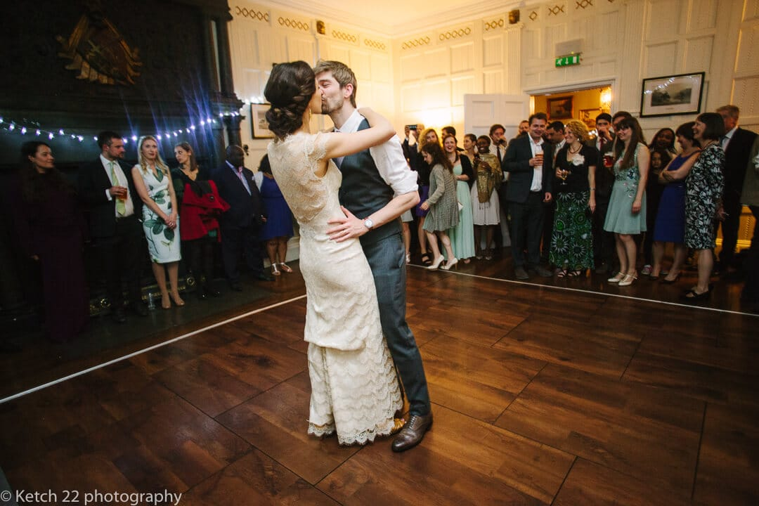 Bride and groom kissing at first dance at Homme House wedding
