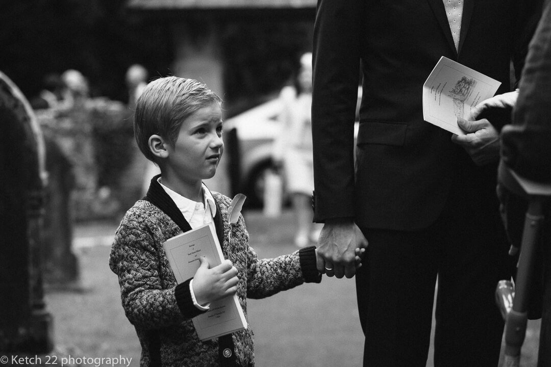 little boy holding Dad's hand at wedding